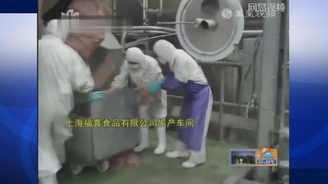 A meat supply company in China is shut down after a television report showed workers using expired meat and meat from the floor.