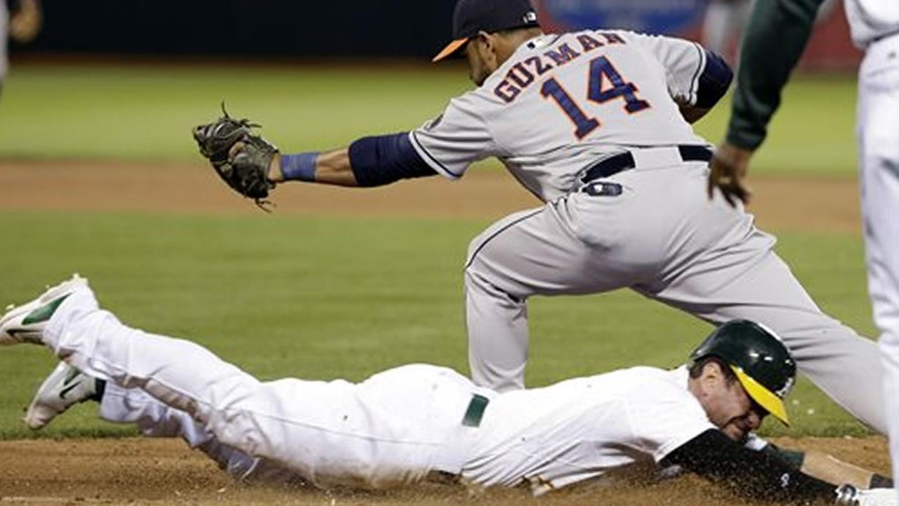 Oakland Athletics Nick Punto slides into first base