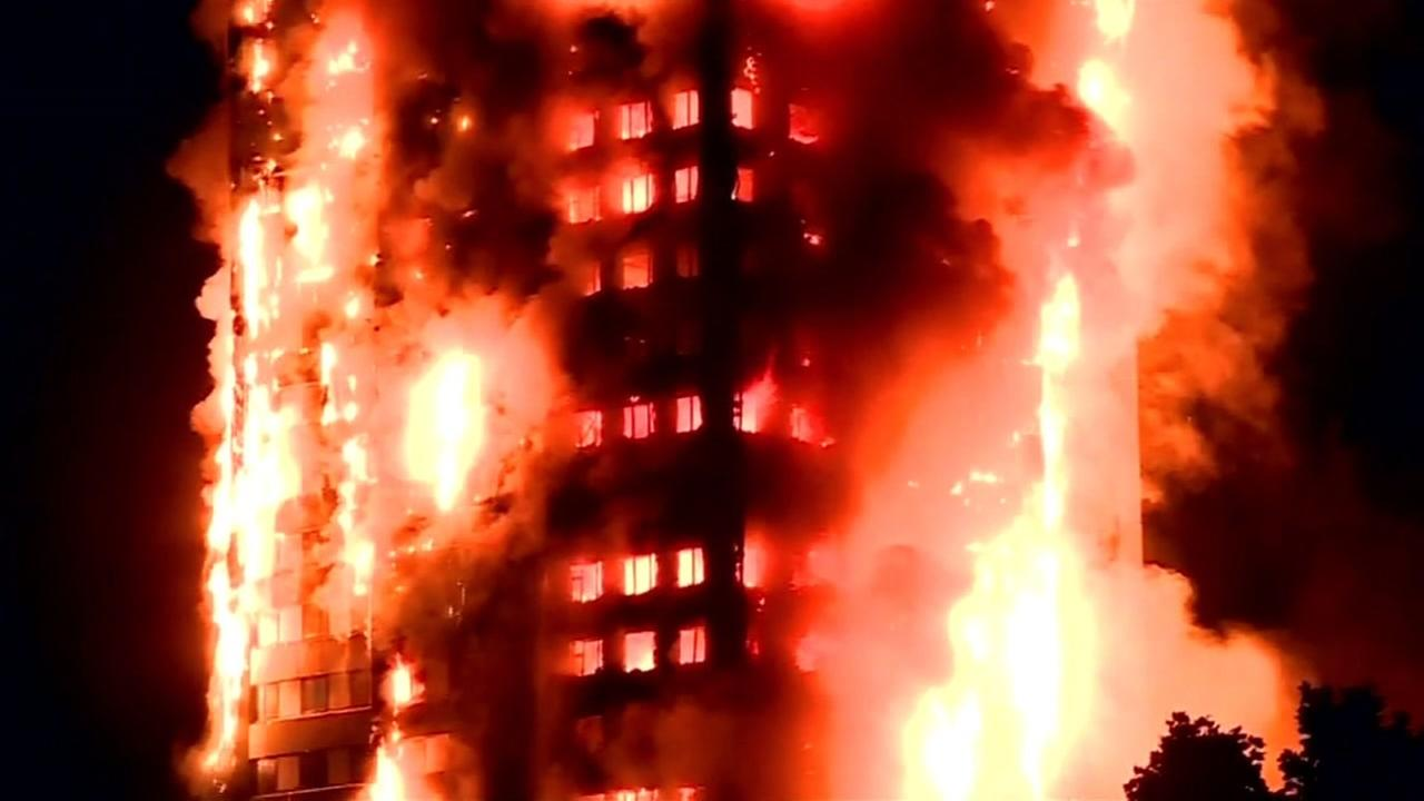 Flames rage through Grenfell Tower in London on Wednesday June 15, 2017.