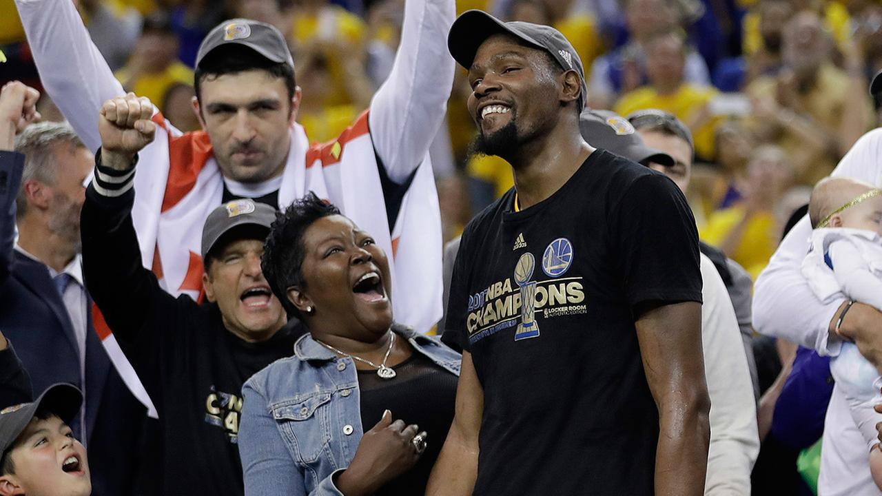 Golden State Warriors forward Kevin Durant celebrates with his mother Wanda Durant as he is named the NBA Finals Most Valuable Player in Oakland, Calif., Monday, June 12, 2017.