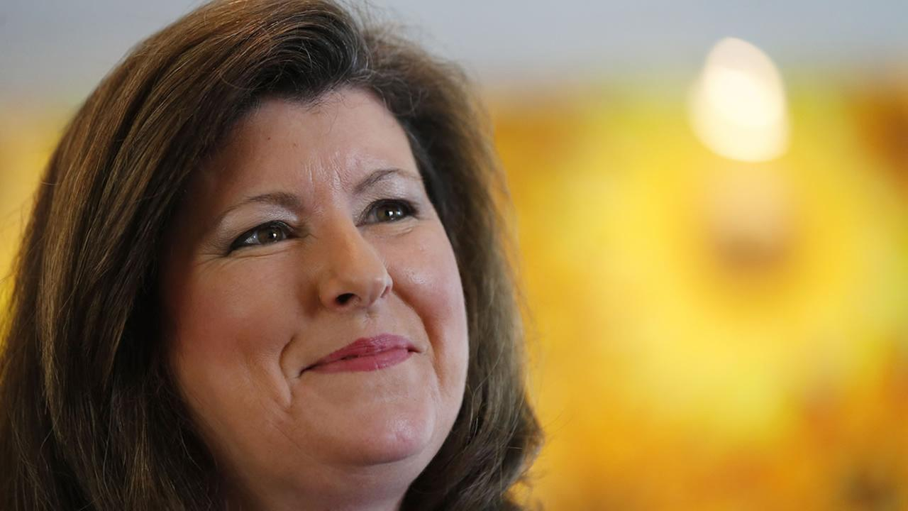 Republican candidate for Senate Karen Handel speaks to a reporter during a campaign stop in Roswell, Ga., Wednesday, May 14, 2014.