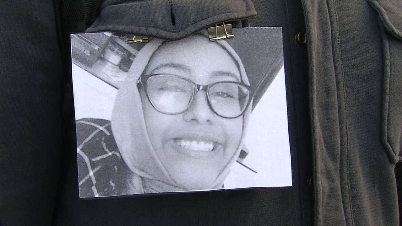 A photograph of Nabra Hassanen is held up during a vigil in San Francisco on Tuesday, June 21, 2017.