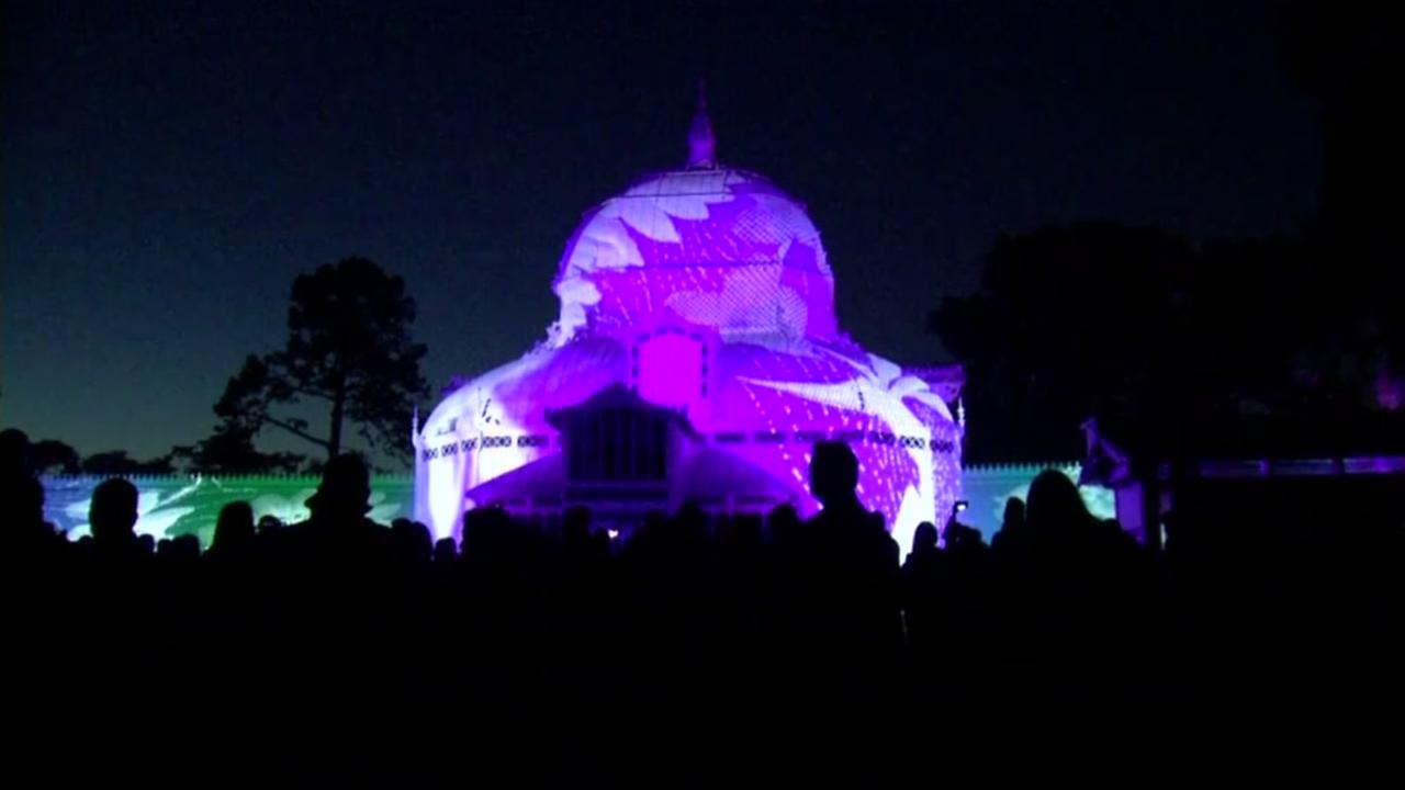 The San Francisco Conservatory of Flowers is seen lit up for the 50th Anniversary of the Summer of Love in San Francisco on Wednesday, June 21, 2017.