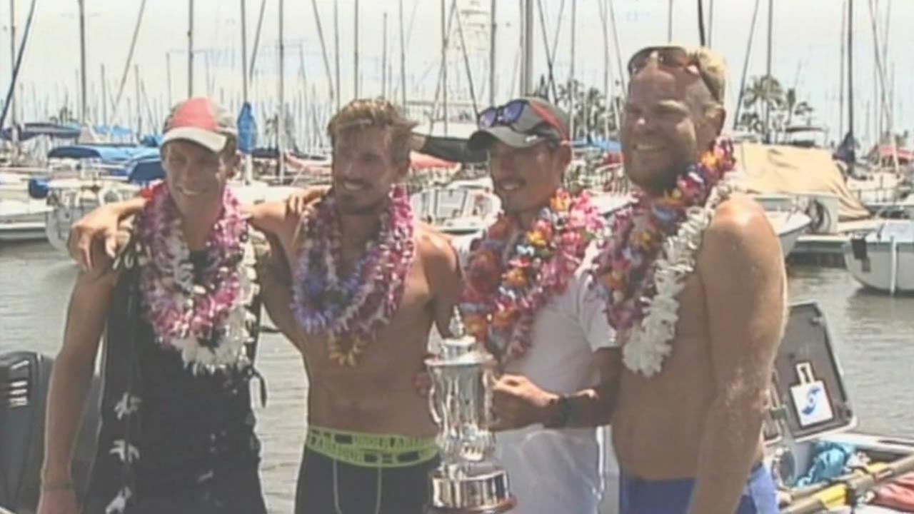 Four-man crew celebrates after finishing first in the Great Pacific Race.