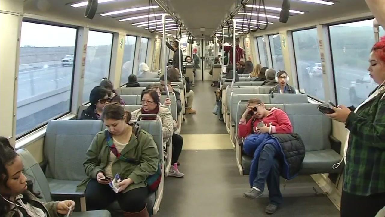 BART riders sit on a train out of San Francisco on Thursday, June 22, 2017.