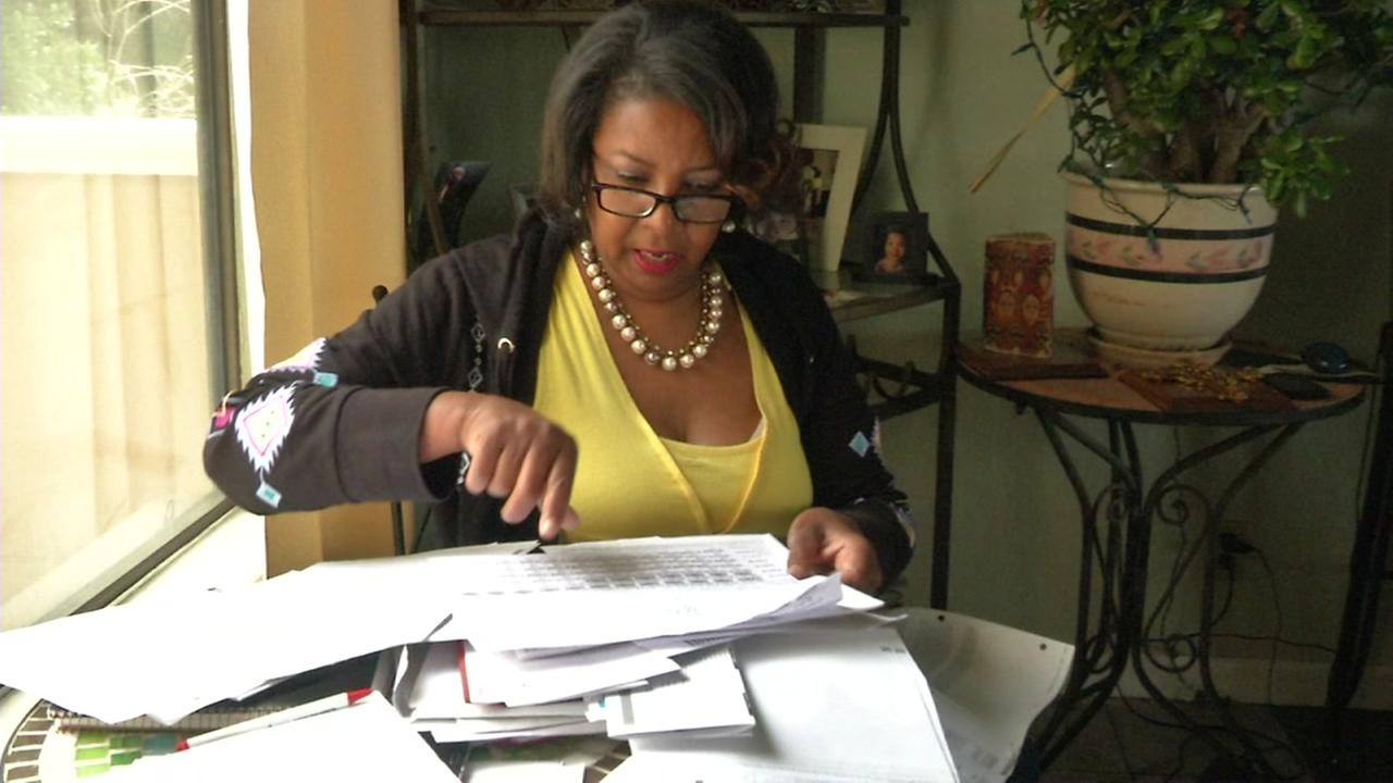 Henrietta Fabio sorts through paperwork in her Oakland, Calif. home on Thursday, June 22, 2017.