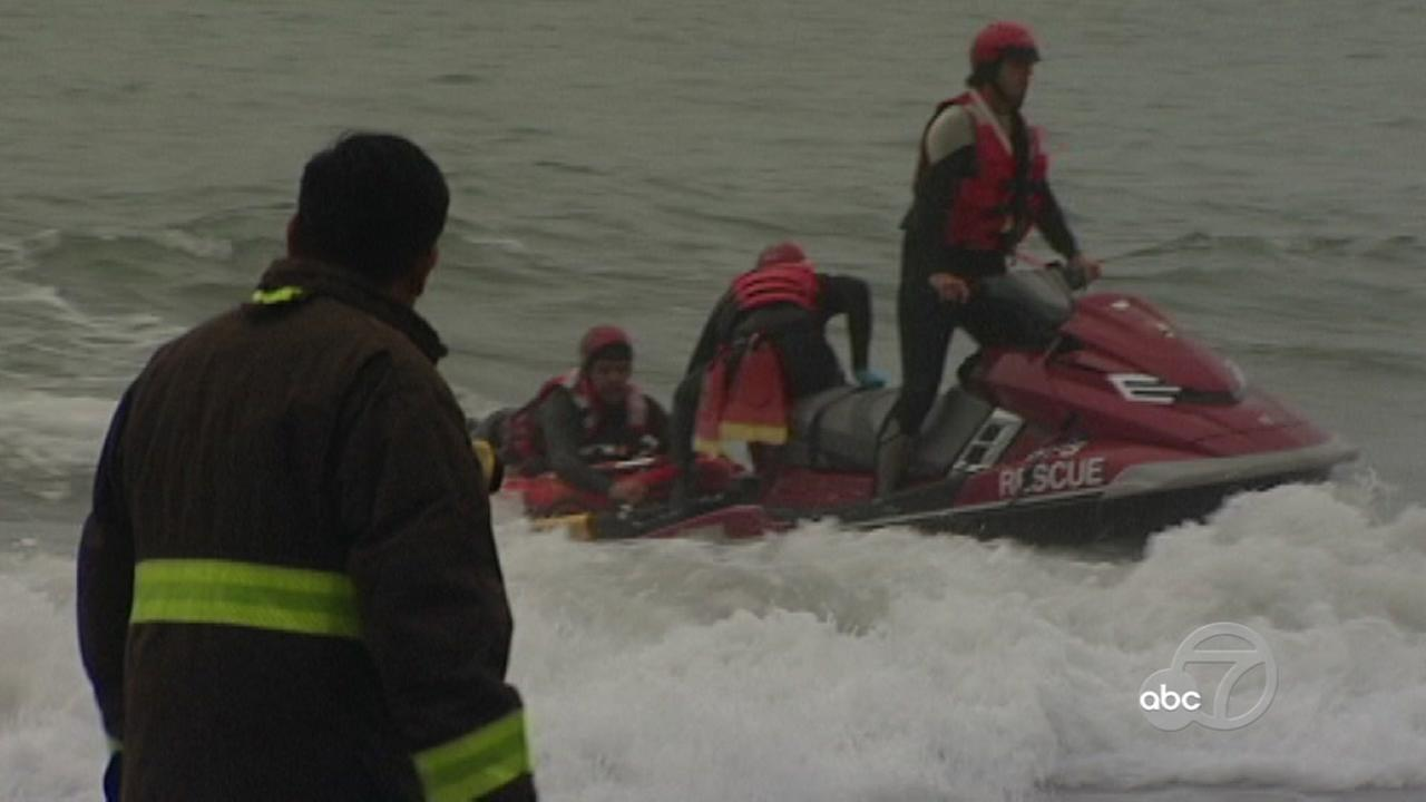 Crews rush to rescue a teenager after she fell off a cliff in San Francisco on June 22, 2017.