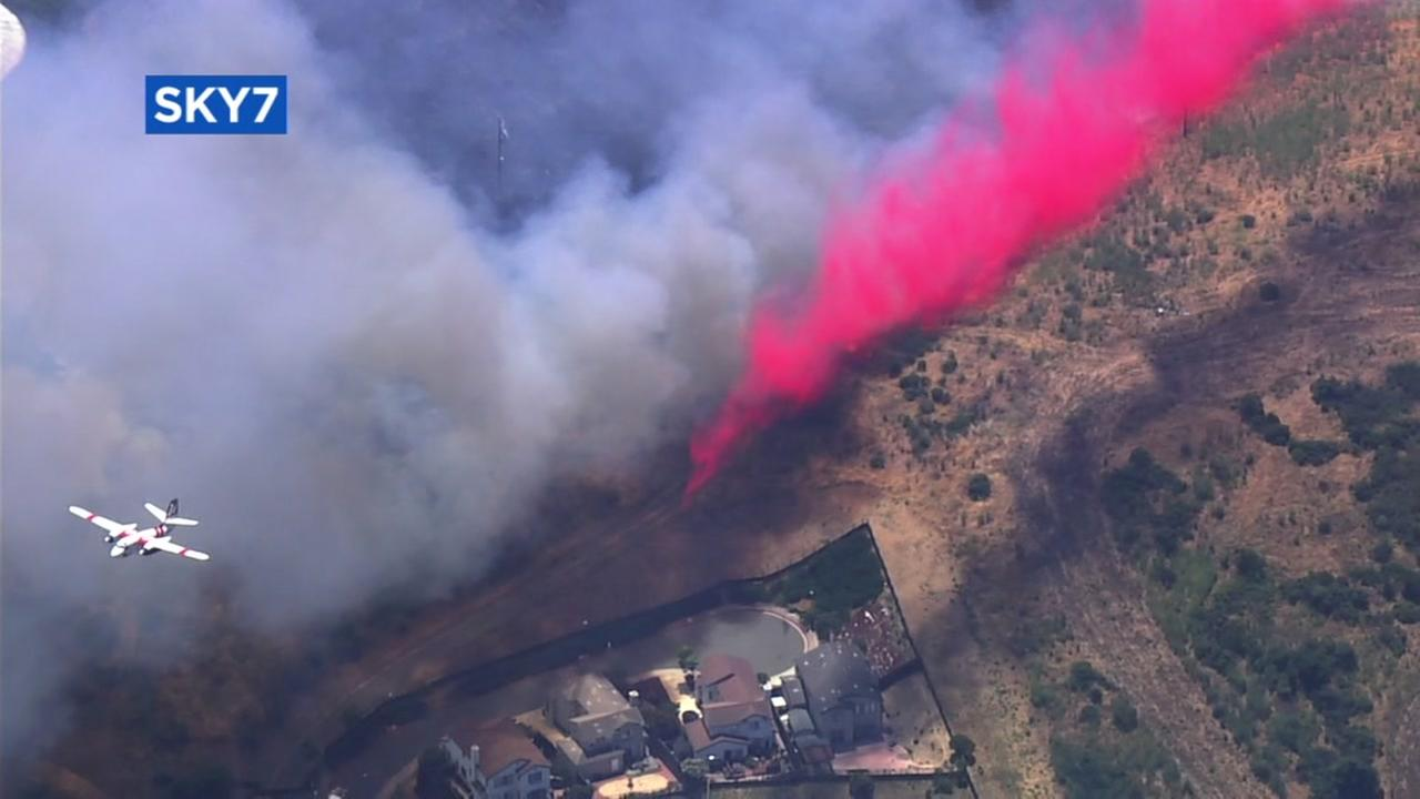 A firefighting aircraft spreads fire retardant over Vallejo, Calif. on June 22, 2017.