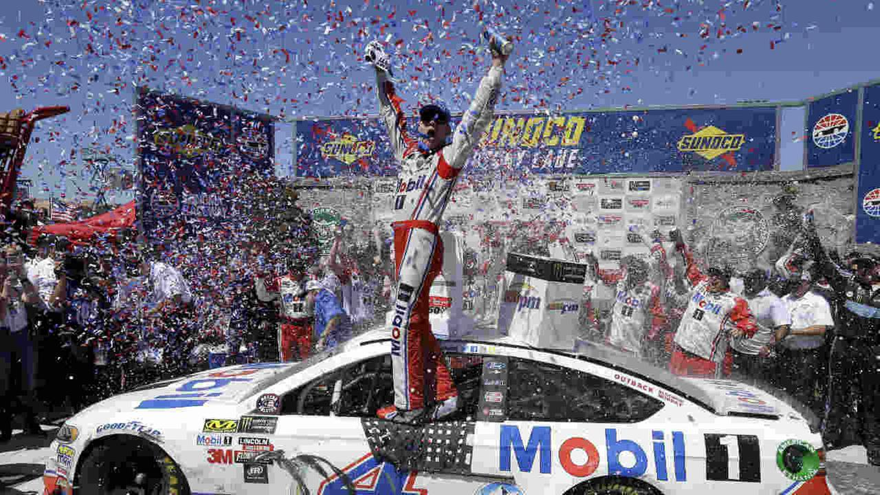 Kevin Harvick celebrates after winning the NASCAR Sprint Cup Series auto race Sunday, June 25, 2017, in Sonoma, Calif.