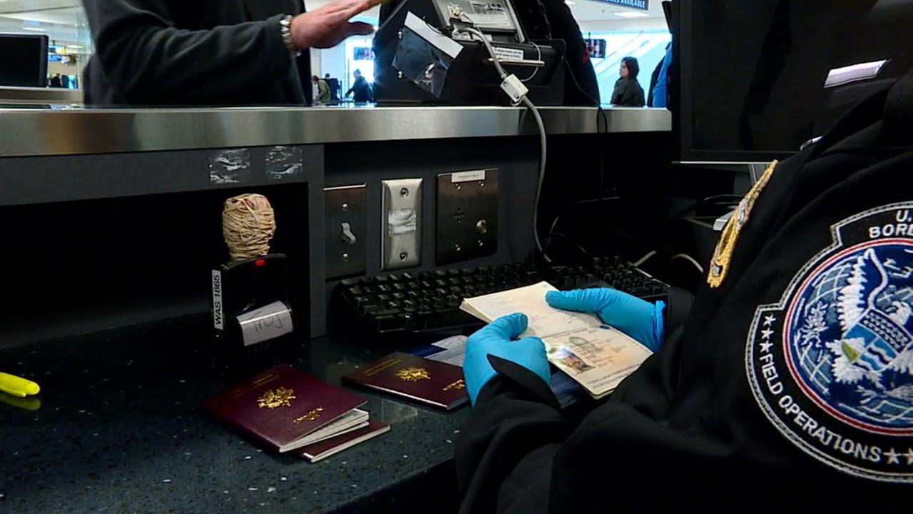 A TSA agent checks a passport at an airport in this undated file photo.