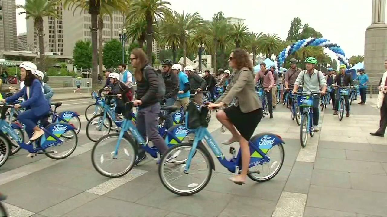 People ride Fords GoBike in San Francisco on Wednesday, June 28, 2017.