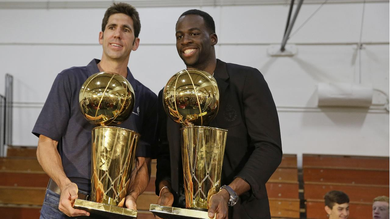 Warriors general manager Bob Myers and forward Draymond Green pose with trophies after an NBA basketball awards news conference, Wednesday, June 28, 2017, in Danville, Calif.