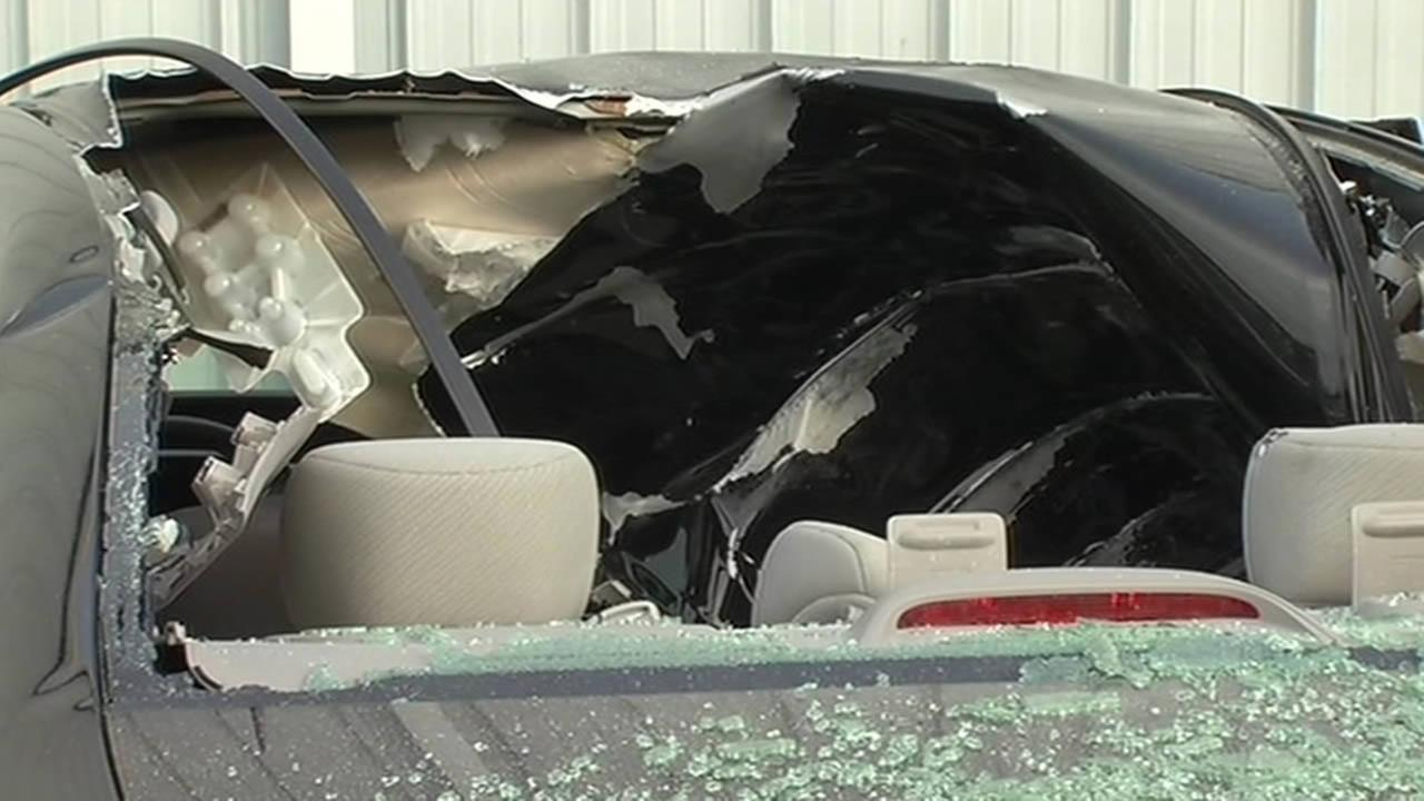 An East Bay metal shop worker is lucky to be alive after debris from a nearby explosion landed on his car while he was asleep inside.
