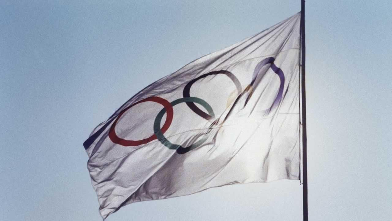 An Olympic flag raised at the games.