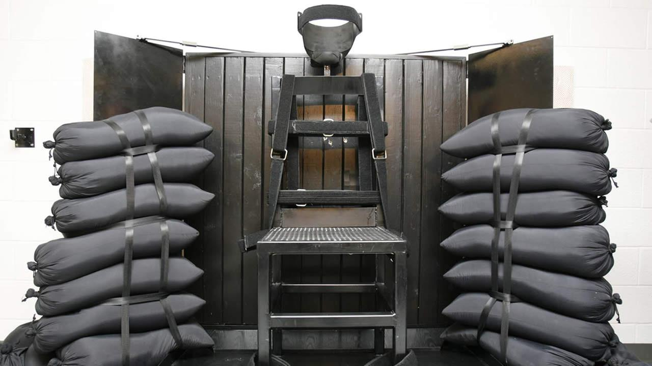 In this June 18, 2010, file photo, the firing squad execution chamber at the Utah State Prison in Draper, Utah, is shown. (AP Photo/Trent Nelson, Pool, File)