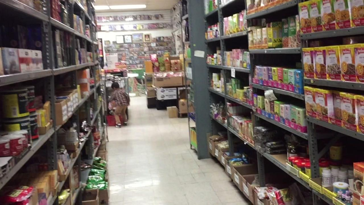 Canned foods sit on shelves in a grocery store aisle in this undated photo.
