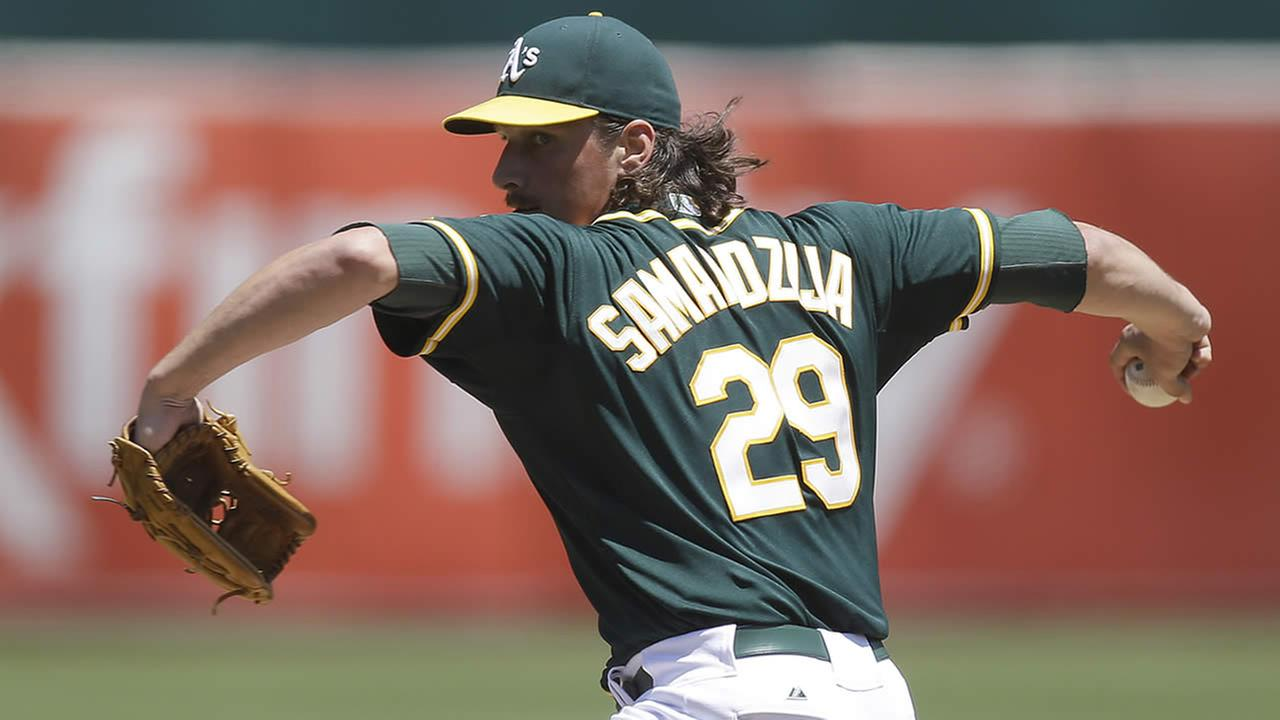 Oakland Athletics Jeff Samardzija works against the Houston Astros in the first inning of a baseball game Thursday, July 24, 2014, in Oakland, Calif. (AP Photo)