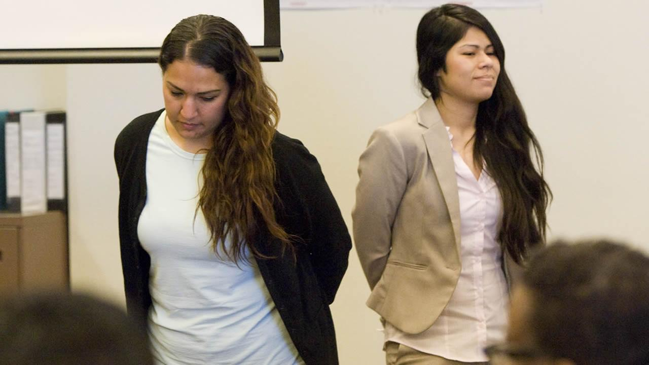 Defendants Candace Brito, left, and Vanesa Zavala enter a Santa Ana, Calif., courtroom Tuesday, July 22, 2014.  (AP Photo/The Orange County Register, Joshua Sudock, Pool)