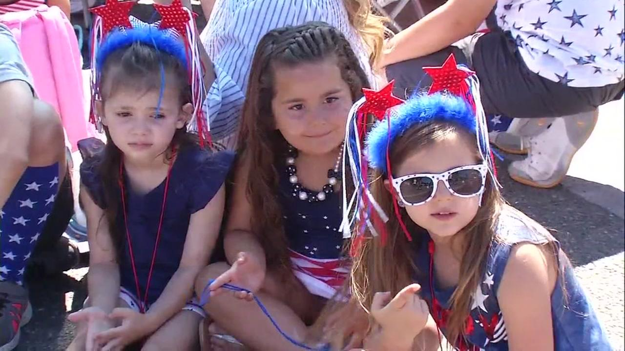 Spectators gather at the Independence Day Parade in Morgan Hill, Calif. on Tuesday, July 4, 2017.