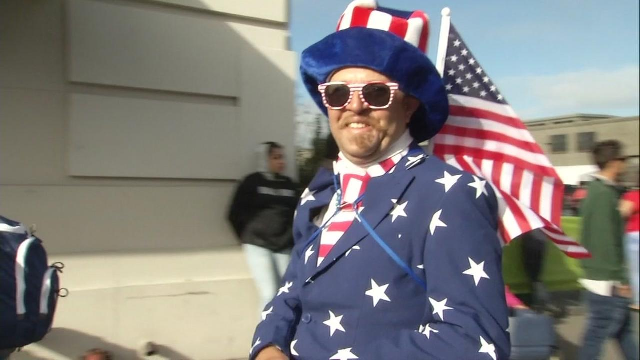 A man celebrates the 4th of July near San Franciscos Embarcadero.