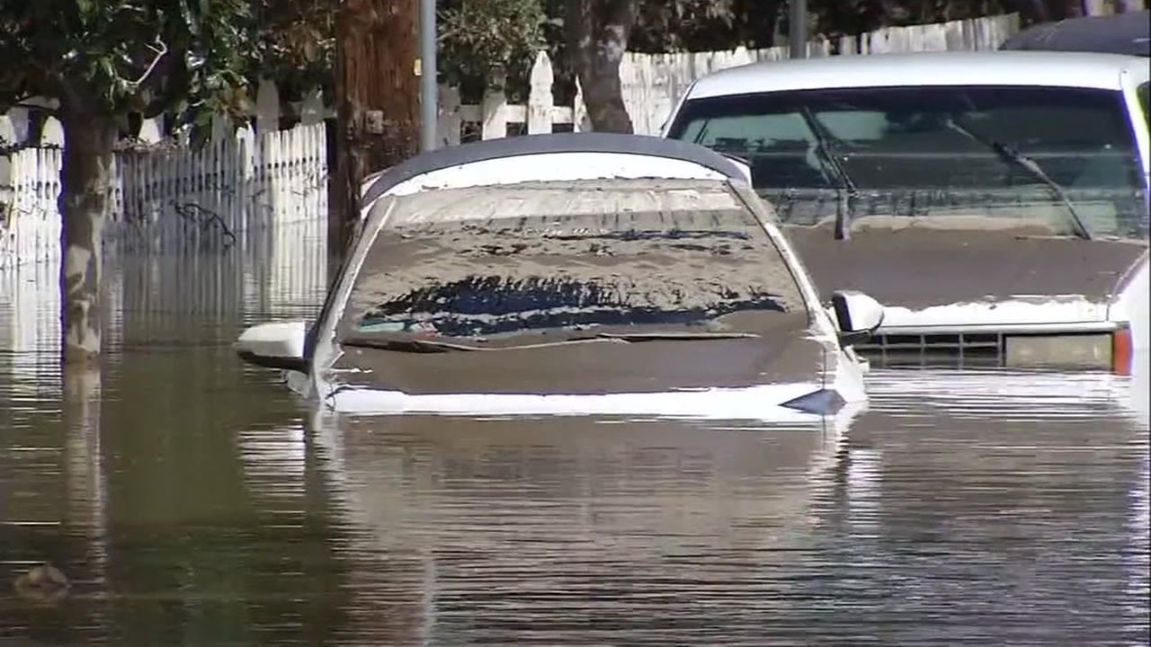 This is an undated image of a car submerged in San Jose, Calif. flood waters during the Coyote Creek floods.
