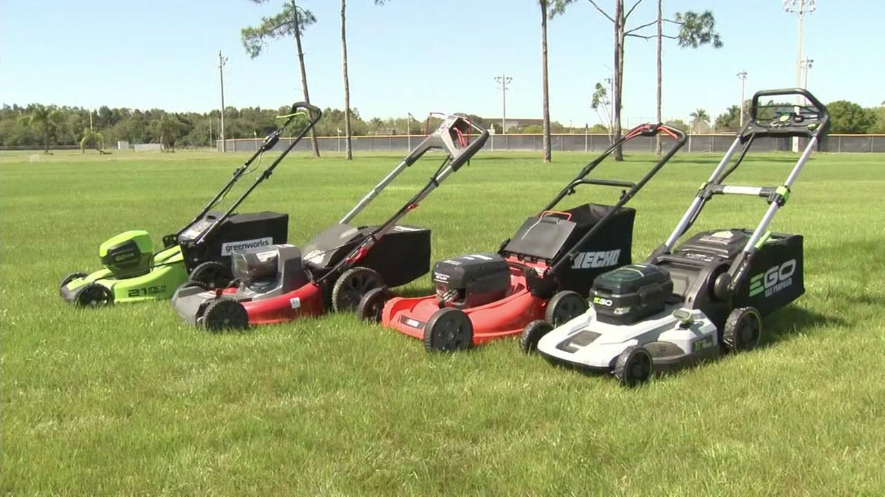 Lawn mowers sit on the grass in this photo taken on Thursday, July 6, 2017.