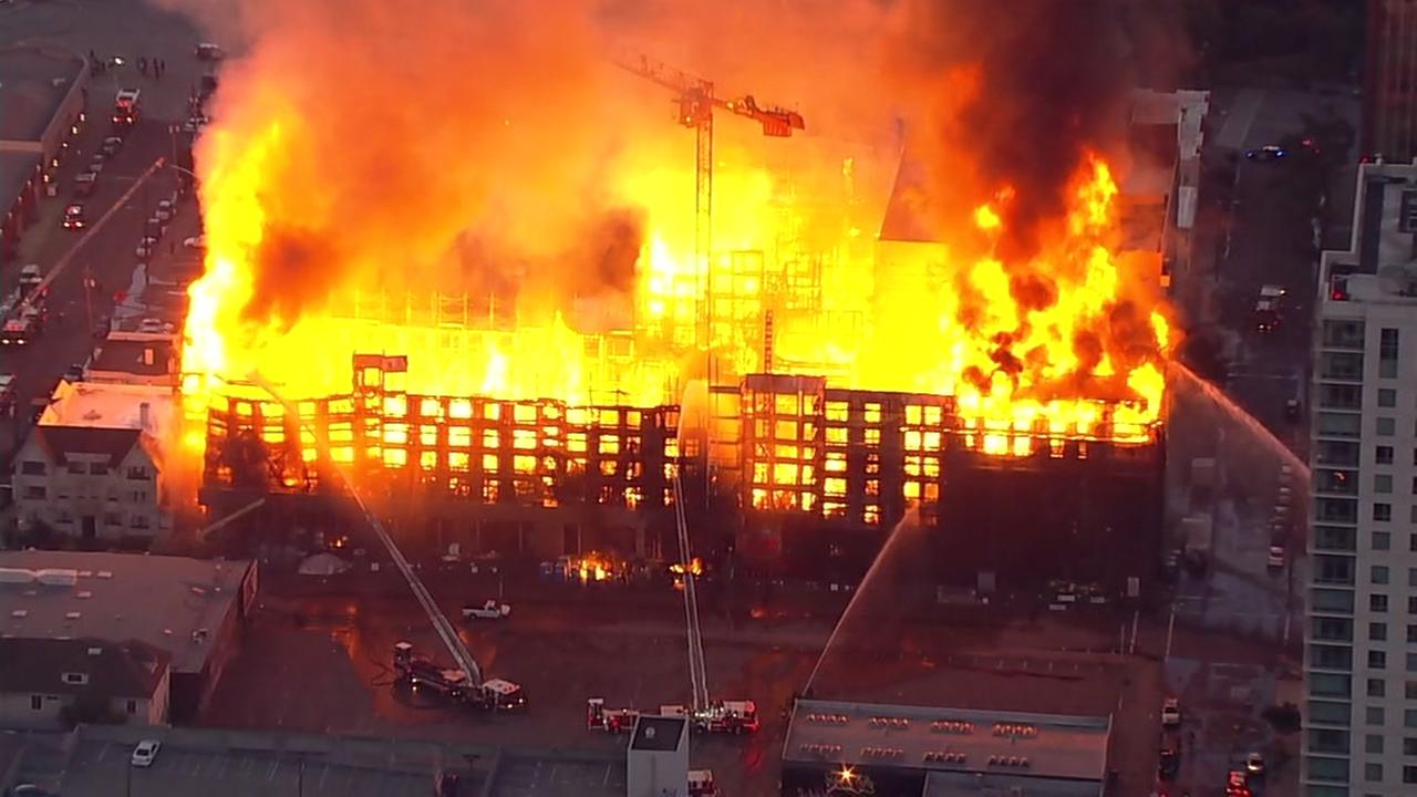 Firefighters battle a massive structure fire in Oakland, Calif. on Friday, July 7, 2017.