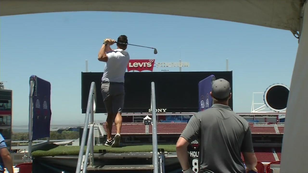 A golfer hits a shot from the upper deck of Levis Stadium during a golf event in Santa Clara, Calif. on July 7, 2017.