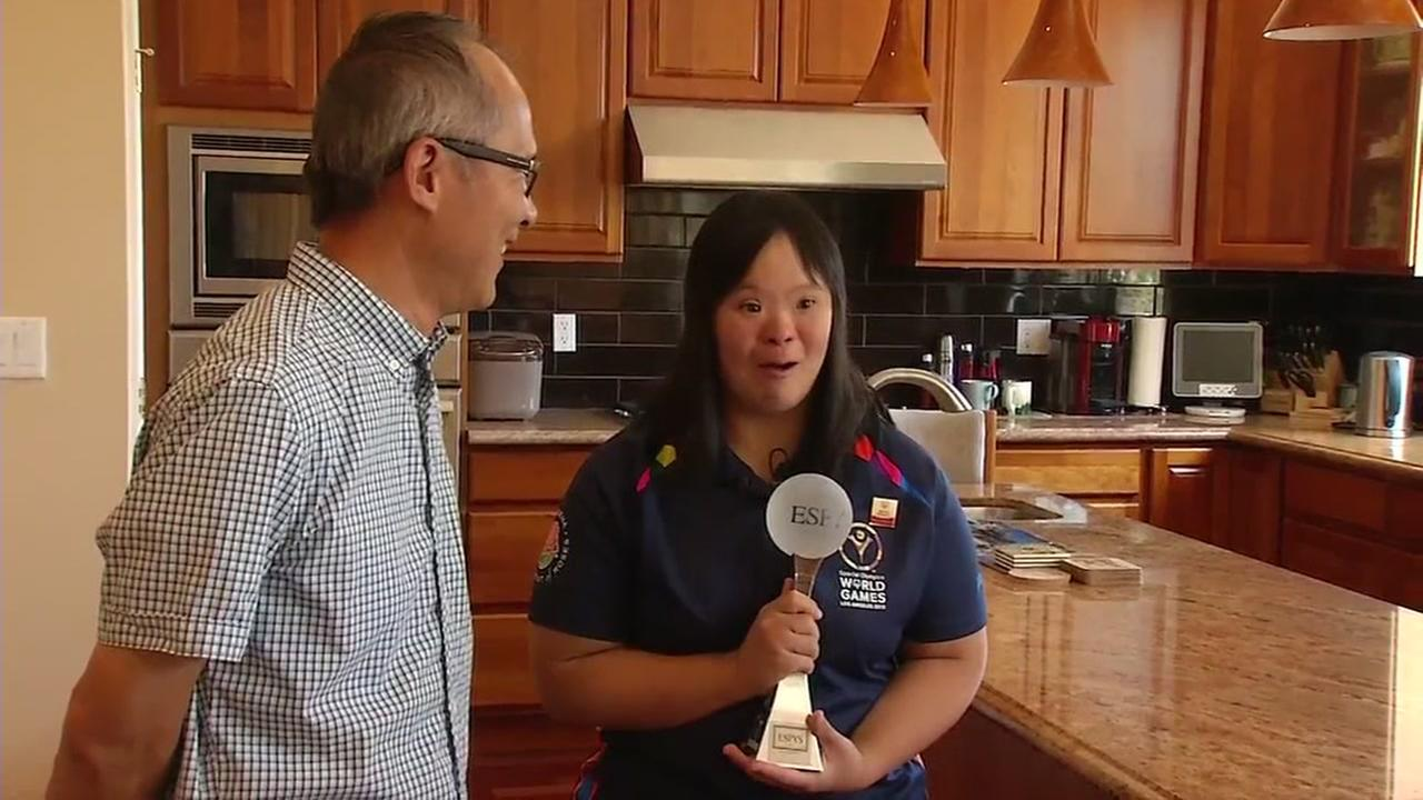Stephanie Ching celebrates her honorary Espy award win with her father Caesar in this undated image.