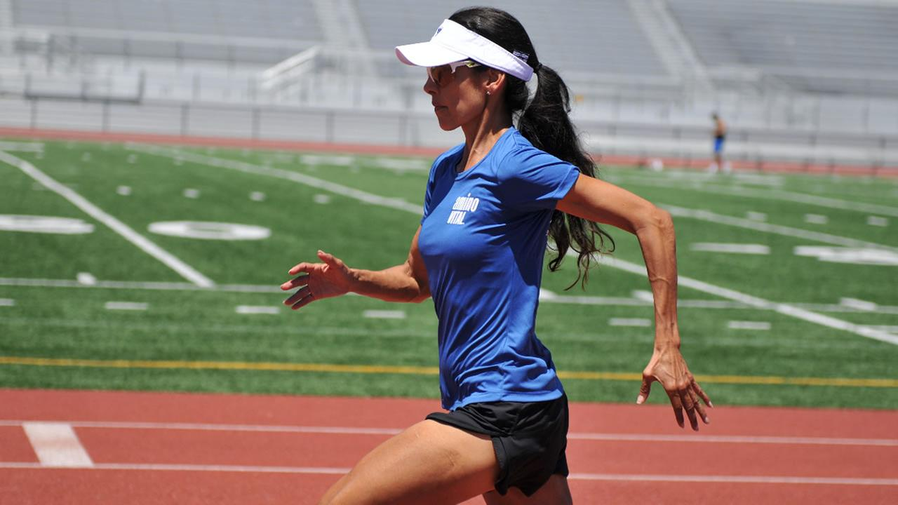 Bree Lambert runs around a track in San Jose, Calif.