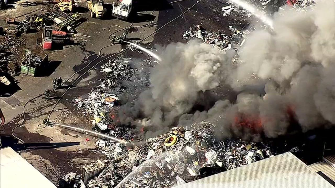 A junkyard is seen on fire in San Leandro, Calif. on Tuesday, July 11, 2017.