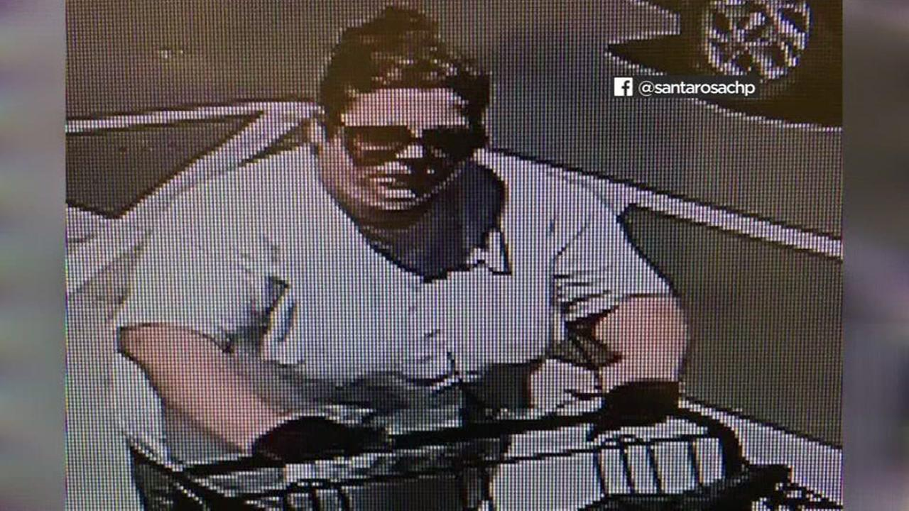 Surveillance video shows a woman leaving a school fundraiser in Santa Rosa, Calif. on Tuesday, July 12, 2017.