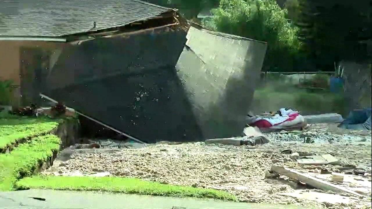 This is an undated image of a Florida home falling into a sinkhole.