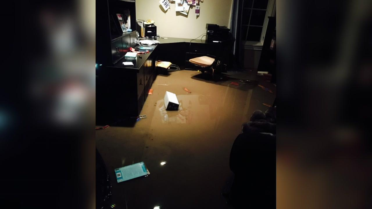 Flood damage is seen inside a Burlingame, Calif. home in this undated image.