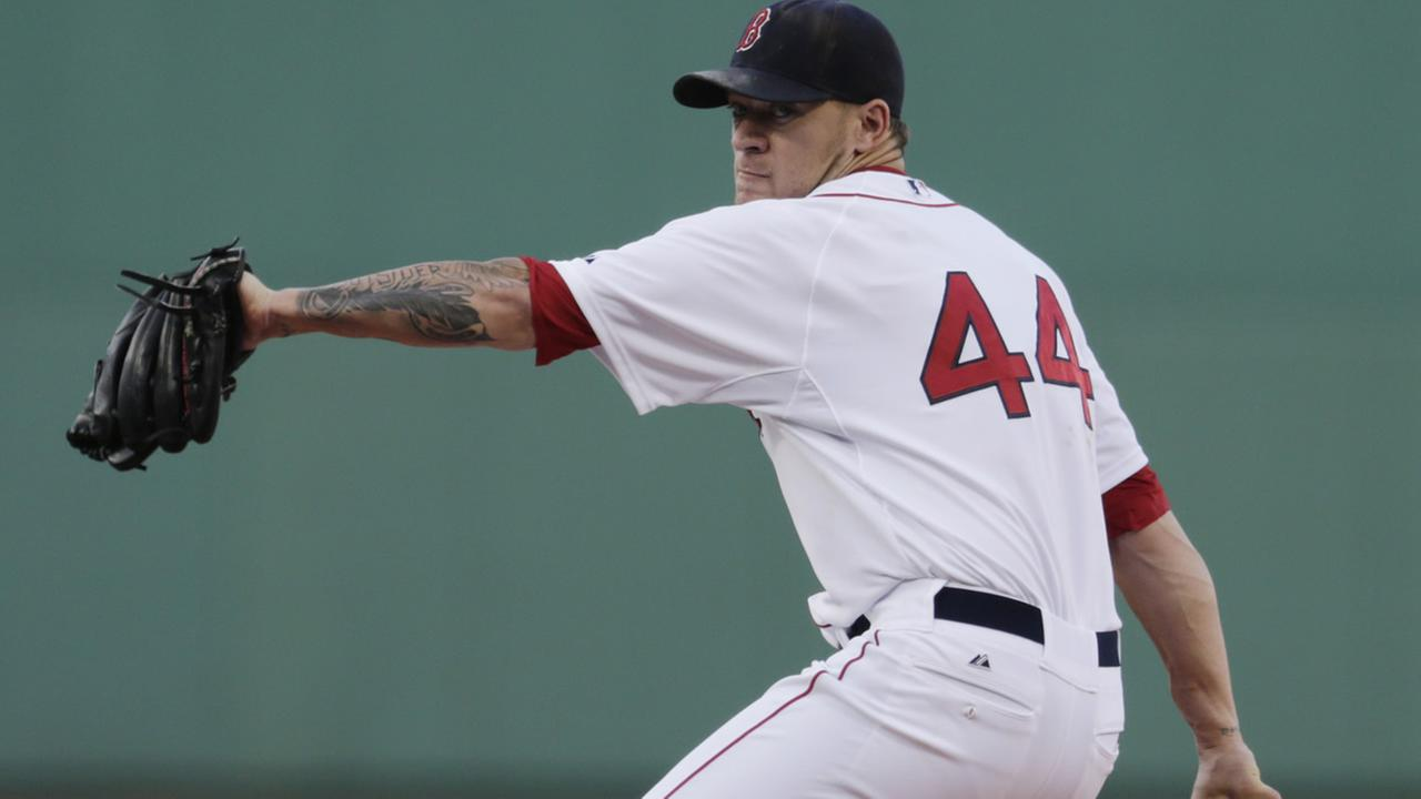 Red Sox starting pitcher Jake Peavy agains the Chicago Cubs during the first inning of a baseball game at Fenway Park in Boston, Monday, June 30, 2014 (AP Photo/Charles Krupa)