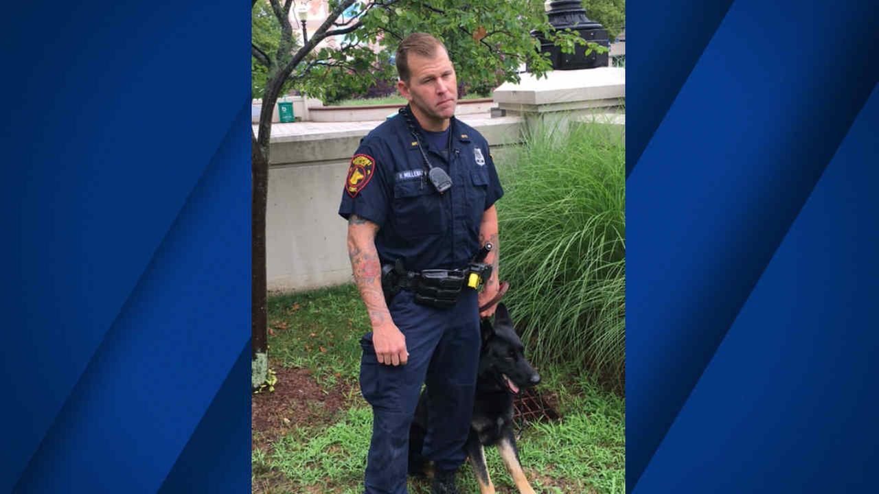 A Bridgeport, Conn. police officer is seen with K-9 Zeus in this undated image.