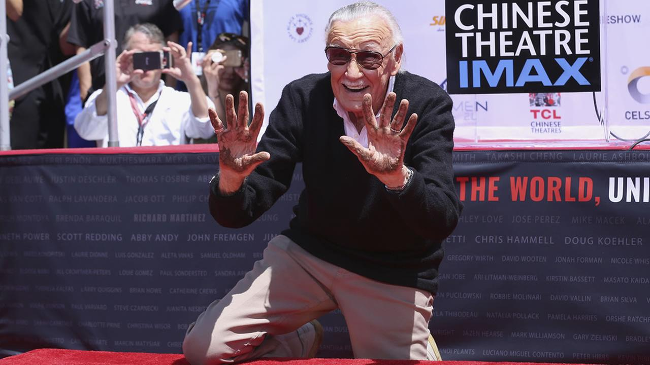 Stan Lee places his hands in cement at his hand and footprint ceremony at the TCL Chinese Theatre on Tuesday, July 18, 2017, in Los Angeles. (Photo by Willy Sanjuan/Invision/AP)