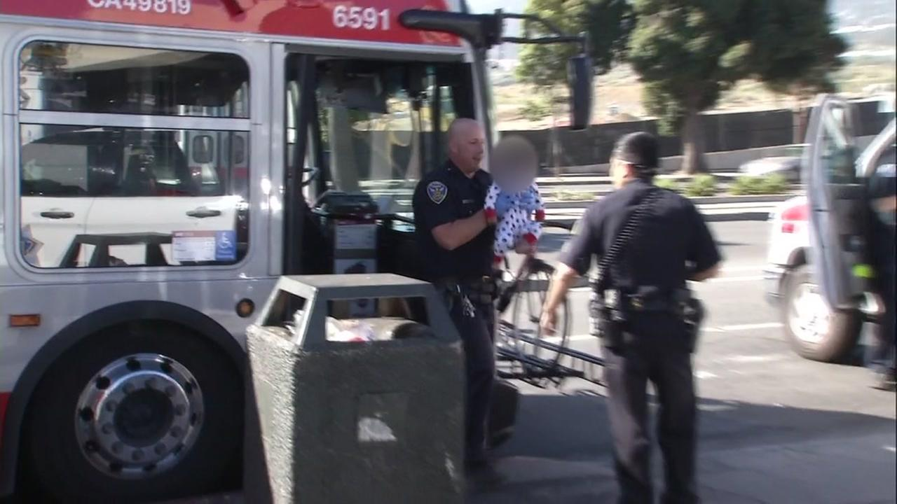 A baby is seen being taken off a Muni bus in this undated image.