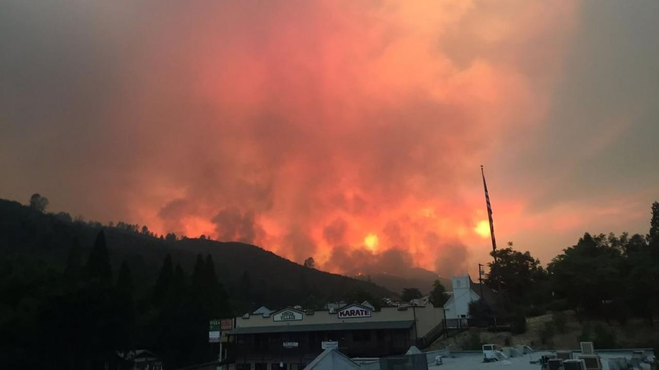 Historic downtown Mariposa is seen threatened by a large wildfire on Tuesday, July 18, 2017.