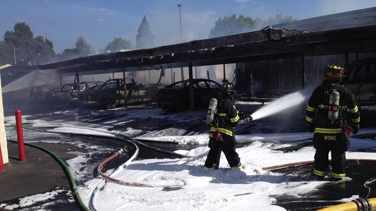 A two-alarm blaze injured one person and damaged 12 vehicles in a carport in Mountain View Saturday evening, fire officials said.