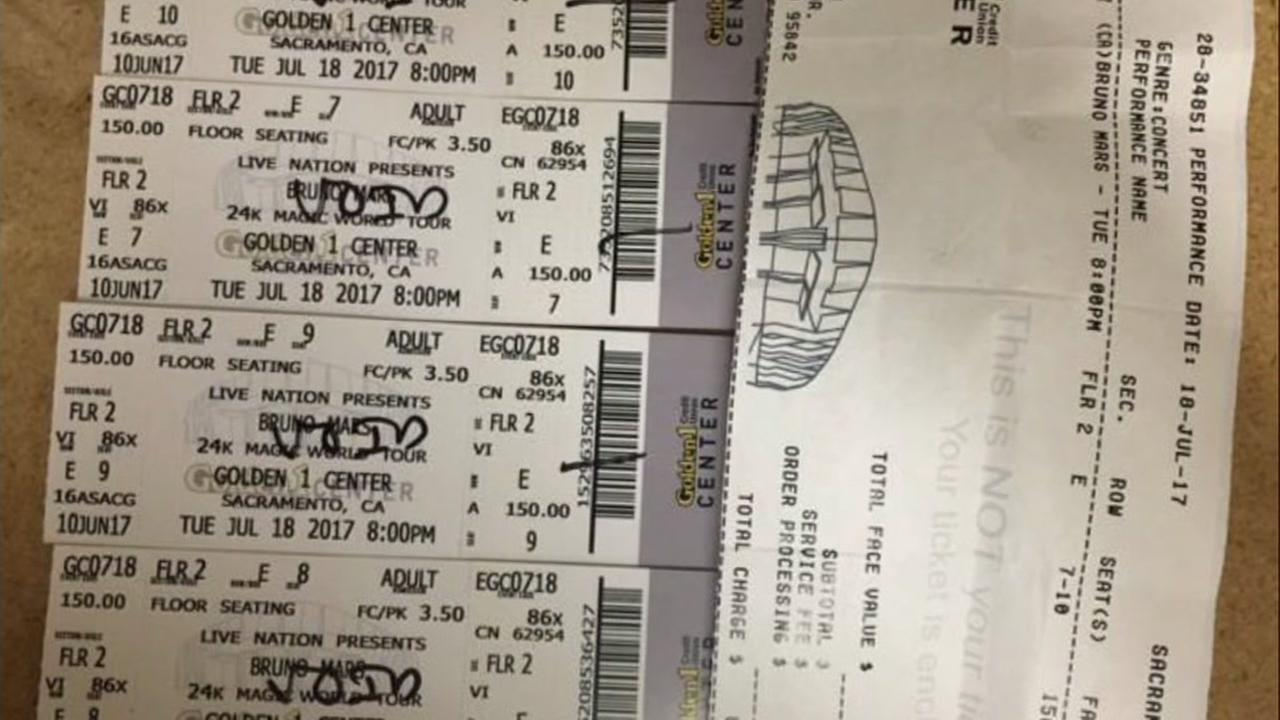 Tickets that turned out to be counterfeit appear after they were voided at a Bruno Mars concert in San Jose, Calif. on Thursday, July 20, 2017.