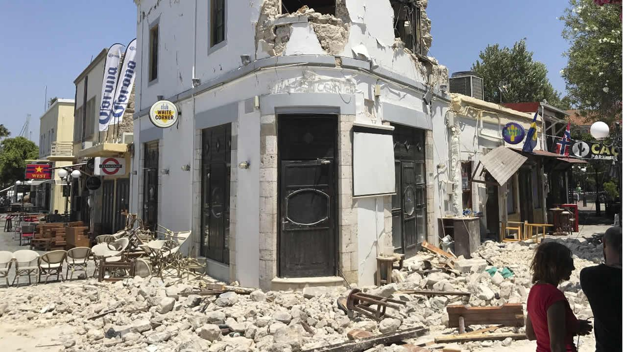Rubble sit outside a bar where two people have been killed after an earthquake in Kos on the island of Kos, Greece Friday, July 21, 2017. (AP Photo/Michael Probst)