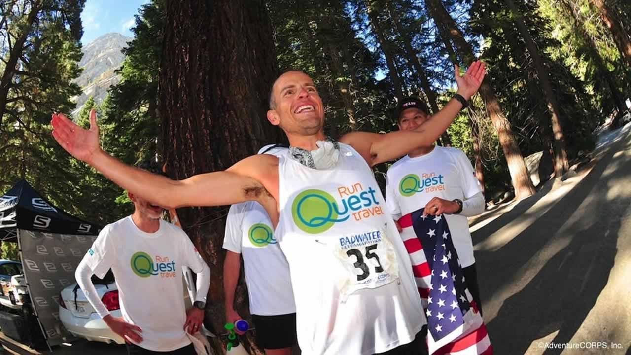 In this Tuesday, July 22, 2014 photo provided by AdventureCORPS, Harvey Lewis, 38, of Cincinnati, celebrates after winning the Badwater 135 ultramarathon. (AP Photo/AdventureCORPS)