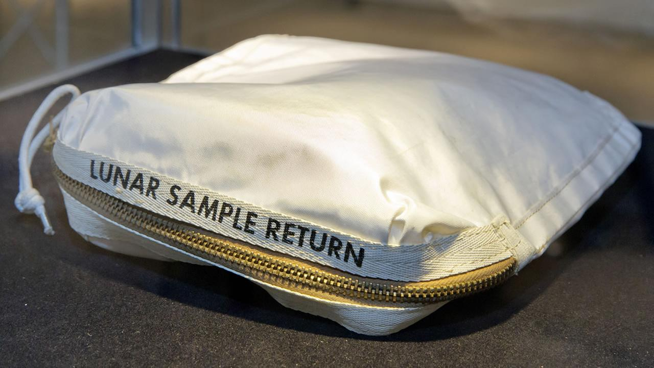 In this July 13, 2017 file photo, The Apollo 11 Contingency Lunar Sample Return Bag used by astronaut Neil Armstrong, to be offered at auction, is displayed at Sothebys, in New York. (AP Photo/Richard Drew, File)