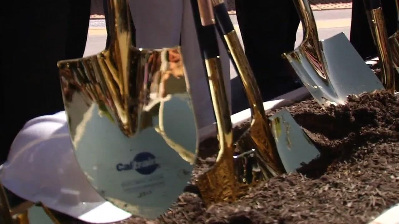 Golden shovels were used to break ground on a major Caltrain project in Millbrae, Calif. on Friday, July 21, 2017.