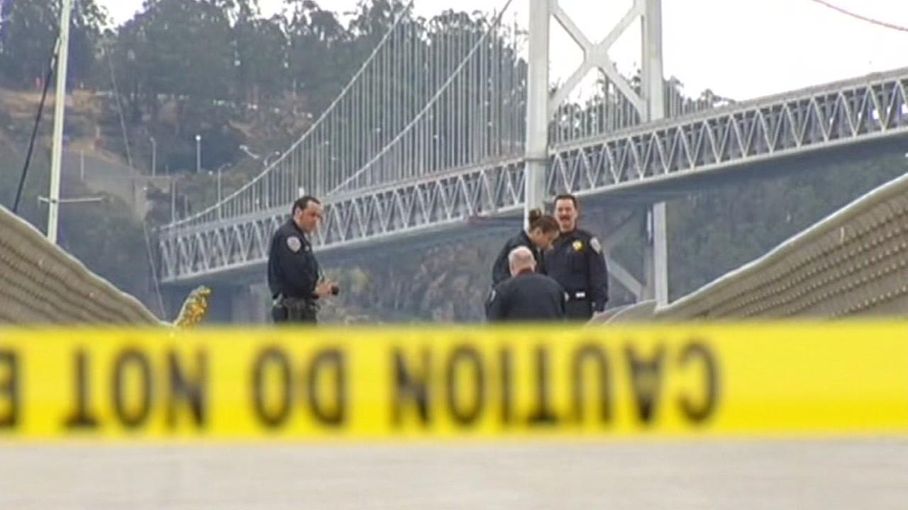 Officers inspect the crime scene where Kate Steinle was shot and killed in this undated image.