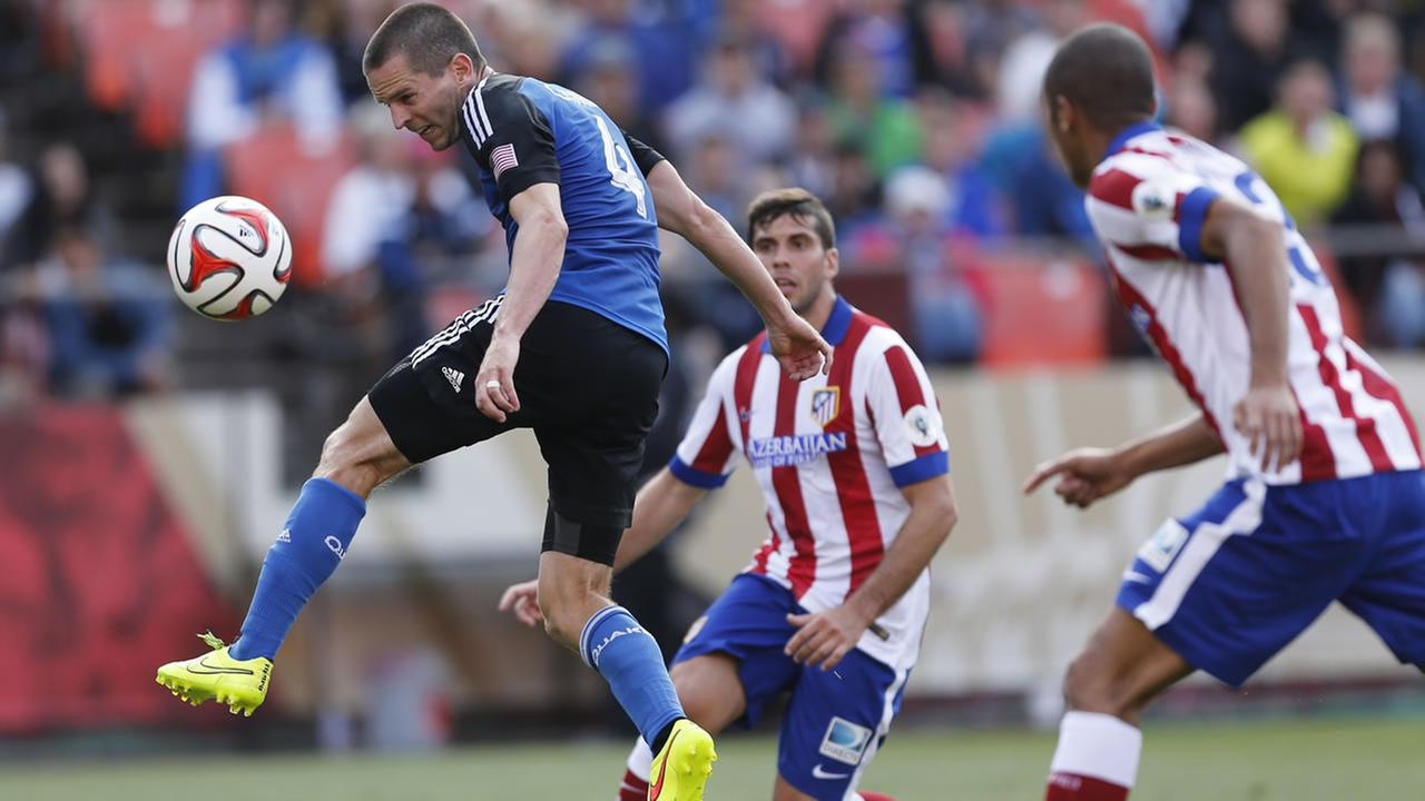 San Jose Earthquakes Sam Cronin leaps for the ball during the second half of a soccer match against Athletico de Madrid, July 27, 2014, in San Francisco (AP Photo/Beck Diefenbach)