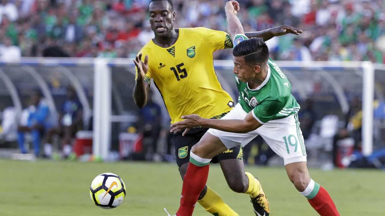 Mexicos Angel Sepulveda and Jamaicas Je-Vaughn Watson battle for the ball during a CONCACAF Gold Cup semifinal soccer match in Pasadena, Calif., Sunday, July 23, 2017.