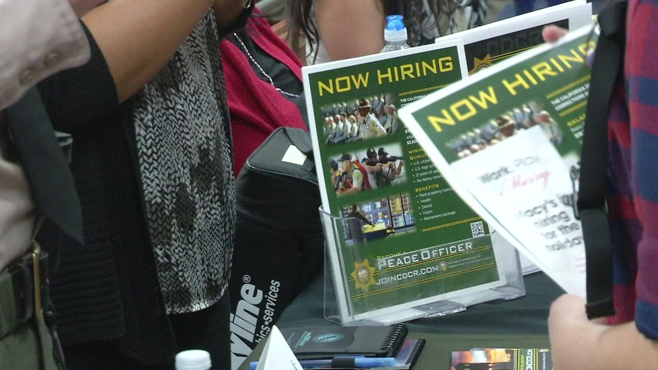 This is an undated image of pamphlets at a job fair.