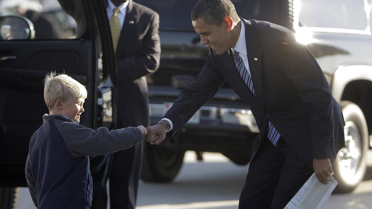Democratic presidential candidate Sen. Barack Obama, D-Ill., right, bumps fists with Ethan Gibbs, 5, Wednesday, Oct. 22,2008, at Dulles International Airport (AP Photo/Jae C. Hong)